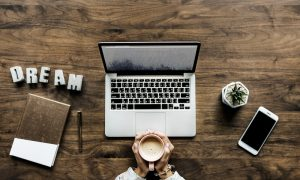 Laptop on a desk with coffee
