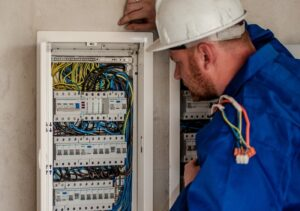 Electrician looking at a panel